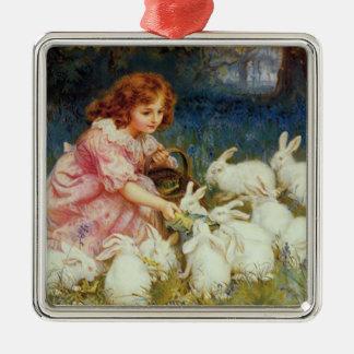 Girl feeding rabbites christmas ornament