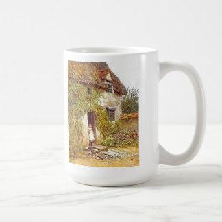 Girl Standing in Doorway of Vintage Country Cottag Coffee Mug