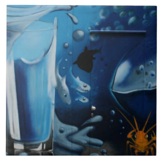 Glass of water and fish tile