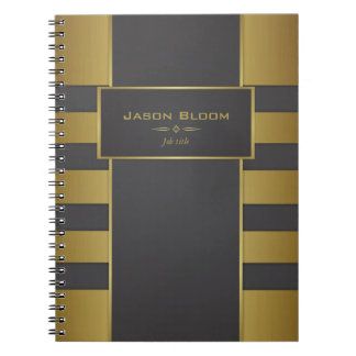 Gold and black spiral notebooks
