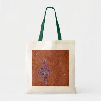 Gold-pink sparkly flower on orange budget tote bag