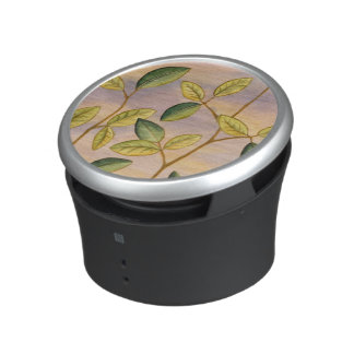Green and Yellow Leaves on Sunset Background Bluetooth Speaker
