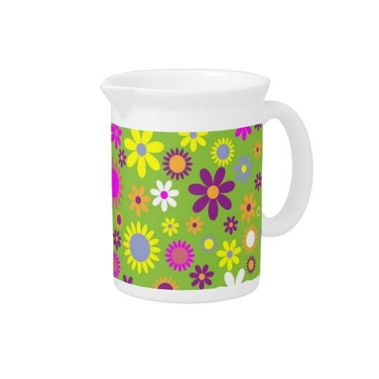 Green background with colourful blossoms pitcher