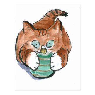 green ornament matches kitten's eyes postcard