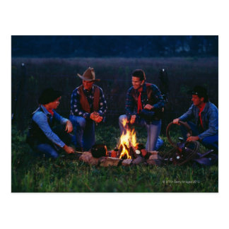 Group of cowboys around campfire postcard