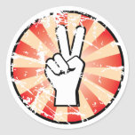 Grunge style peace hand sign classic round sticker