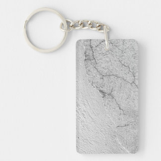 Grungy white stucco wall background key ring
