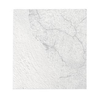 Grungy white stucco wall background notepad