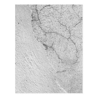 Grungy white stucco wall background postcard