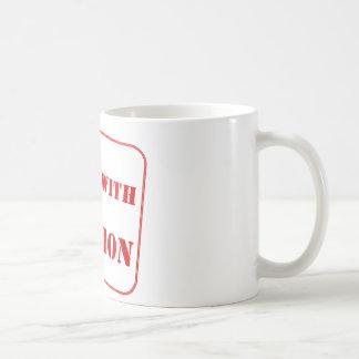 Handle with caution coffee mug