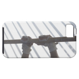 Hands of a male gymnast gripping a horizontal iPhone 5 cover