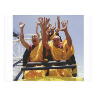 Happy buddhist monks on a roller coaster postcard