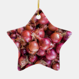 Heap of red onions on market christmas ornament
