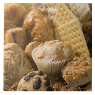 High angle view of muffins and crackers in a large square tile