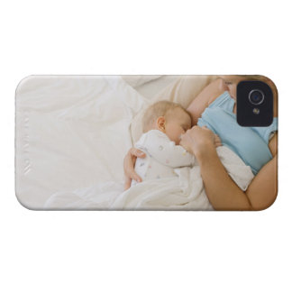 High angle view of woman breastfeeding baby iPhone 4 cover