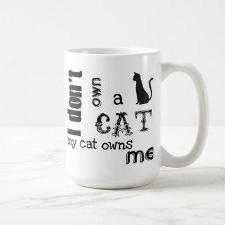 I don't own a cat My cat owns Me Cute mug
