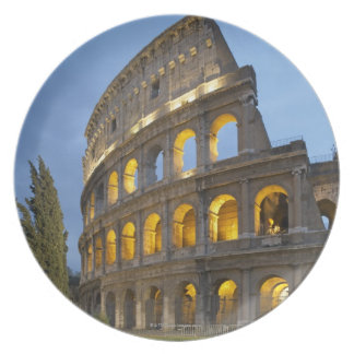 Illuminated section of the Colosseum at dusk. Plate