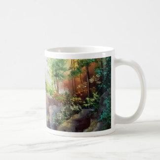 in the woods near the waterfall coffee mug