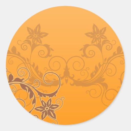 Inspiring brown floral on orange background round sticker