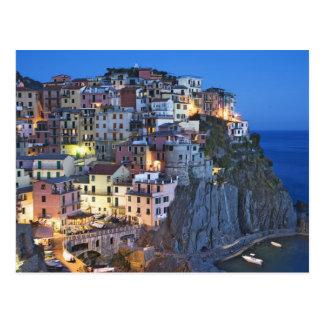 Italy, Manarola. Dusk falls on a hillside town Postcard