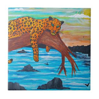 Jaguar reposing on branch tile