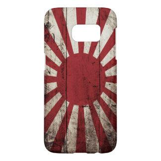 Japan Rising Sun Flag on Old Wood Grain