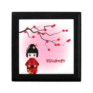 Japanese kokeshi doll at sakura blossoms gift box