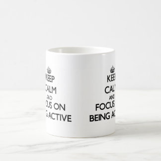 Keep Calm and focus on Being Active Mugs