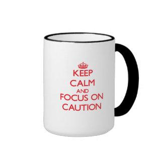 Keep Calm and focus on Caution Mugs