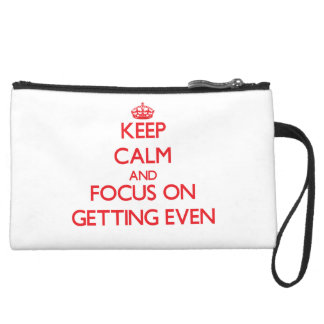 Keep Calm and focus on GETTING EVEN Wristlet