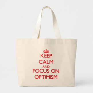 kEEP cALM AND FOCUS ON oPTIMISM Canvas Bags