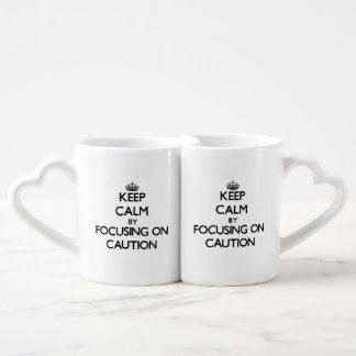Keep Calm by focusing on Caution Lovers Mug Sets