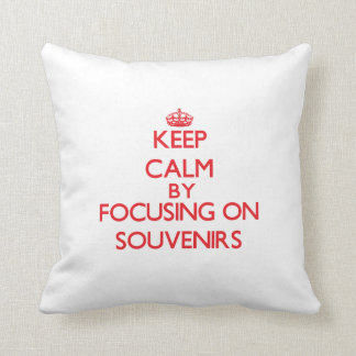 Keep calm by focusing on on Souvenirs Throw Pillow
