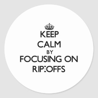 Keep Calm by focusing on Rip-Offs Round Stickers