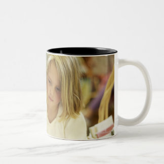 Kids in a library Two-Tone coffee mug