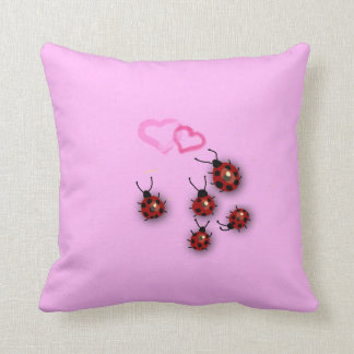 Ladybirds and hearts throw pillows