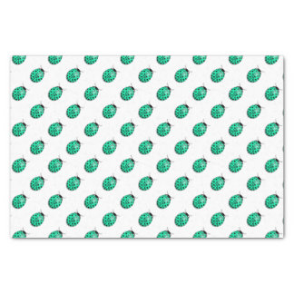 Ladybug in teal blue-green tissue paper