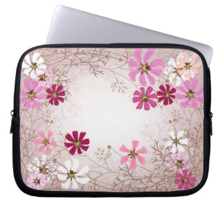 Laptop sleeve  with tender floral background.
