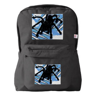 Large spider on metal surface backpack