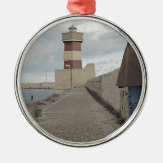 Lighthouse passerby man standing christmas ornament