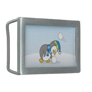 Little penguin getting a snow ball rectangular belt buckle
