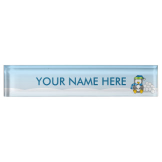 Little penguin sitting with snowballs name plate