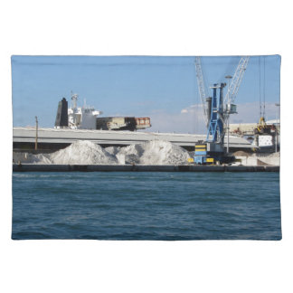 Loading cargo of raw materials from a port mooring cloth placemat