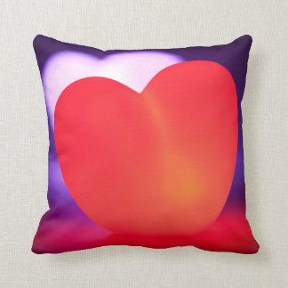 Love heart glowing red with heart behind throw pillow