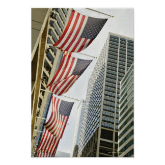 Low angle view at American flags in downtown Poster
