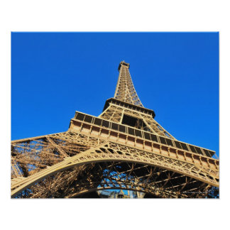 Low angle view of Eiffel Tower against blue sky Poster