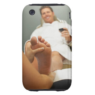 Low angle view of man receiving foot massage tough iPhone 3 case