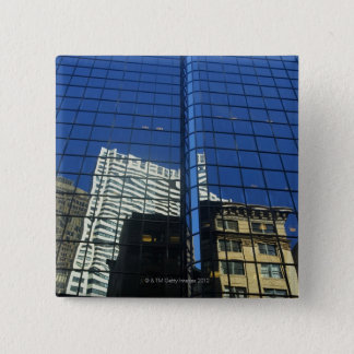 Low angle view of the reflection of buildings on 15 cm square badge