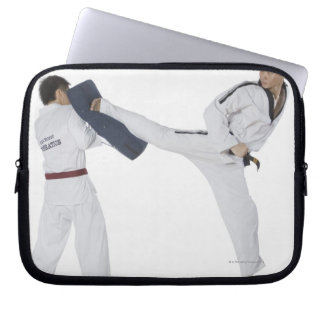 Male karate instructor teaching martial arts to 2 laptop sleeve