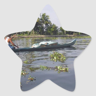 Man boating on the salt water lagoon in Alleppey Sticker